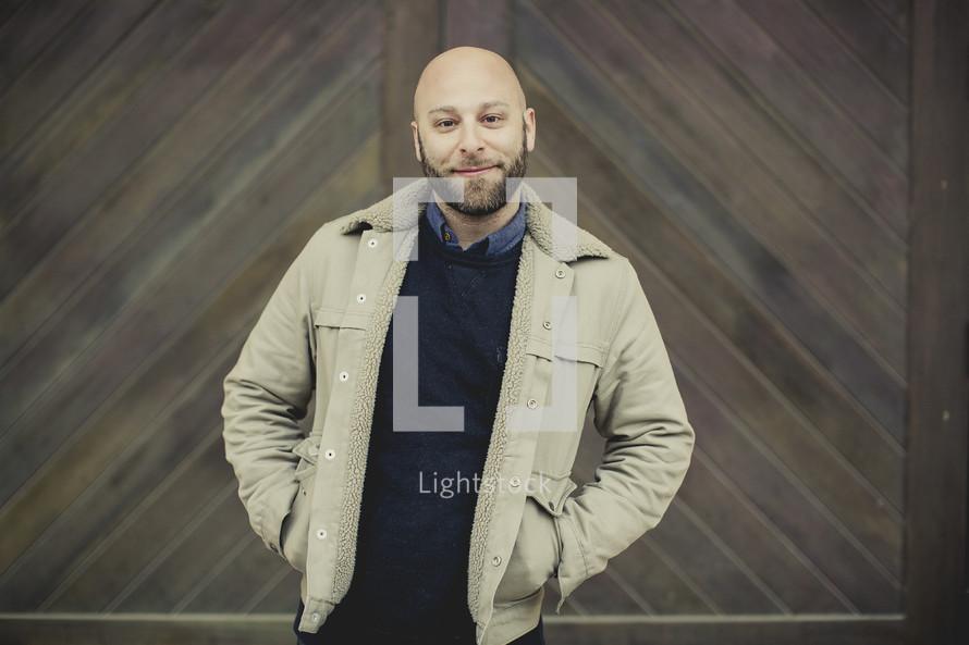 man standing in front of wood doors