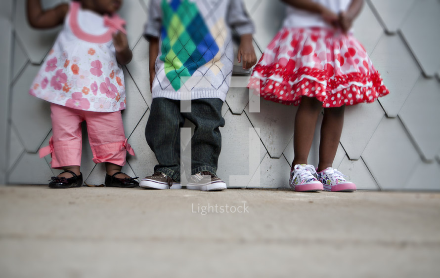 Children standing on sidewalk