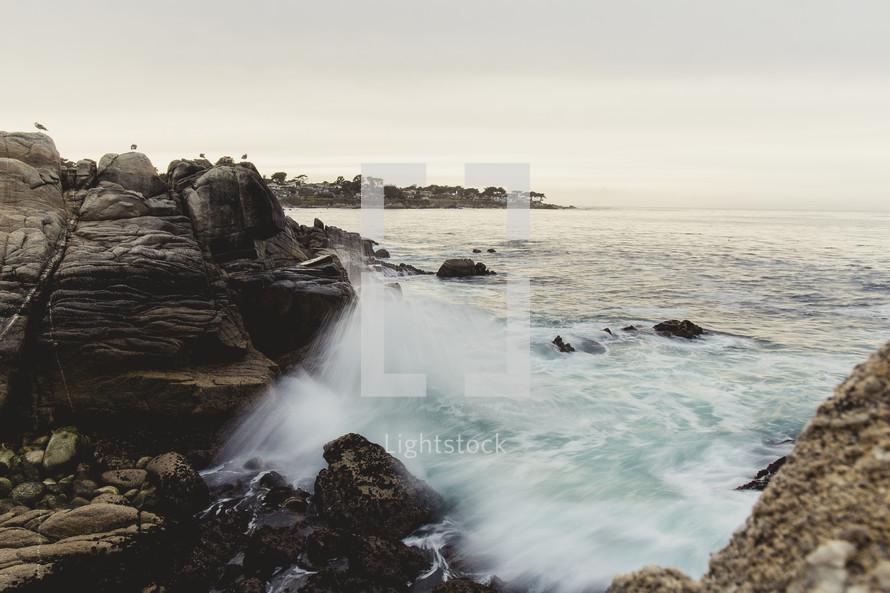 tide washing over rocks in the ocean