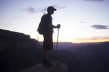 Silhouette of a mountain climber at sunrise.
