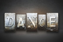 Stone tiles spelling the word DANCE.