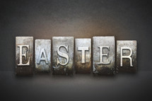 Stone tiles spelling the word EASTER.