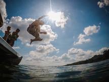 kids jumping into a lake