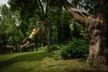 boy on a rope swing