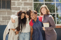 woman's group standing outdoors holding Bibles