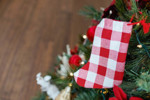 red and white gingham Christmas stocking