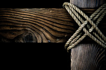 Wooden cross connected with rope