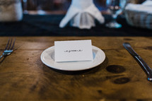 groom place card at a wedding reception