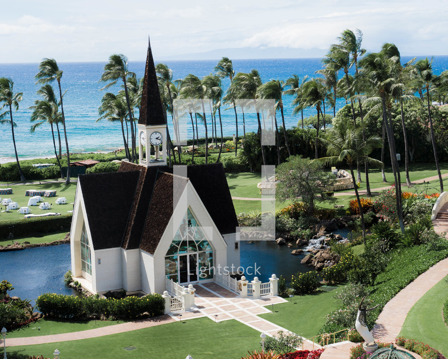 church surrounded by palm trees and ocean view