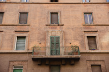 terrace and windows on the side of a building in Rome