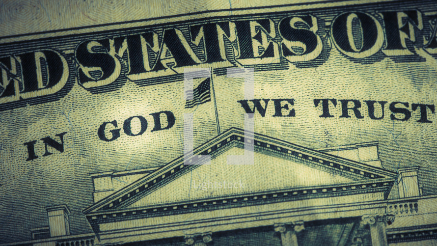 "A close up of the phrase ""In God We Trust"" on a dollar bill"