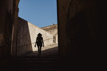 silhouette of a woman walking up stairs in Italy