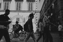 people walking in a courtyard in Italy