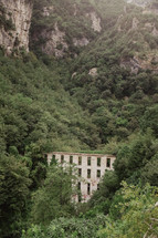 stone wall ruins on mountainous landscape in Italy