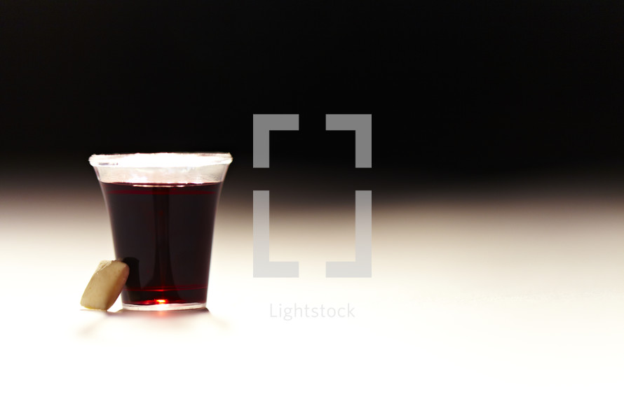 A Communion cup of wine and a wafer