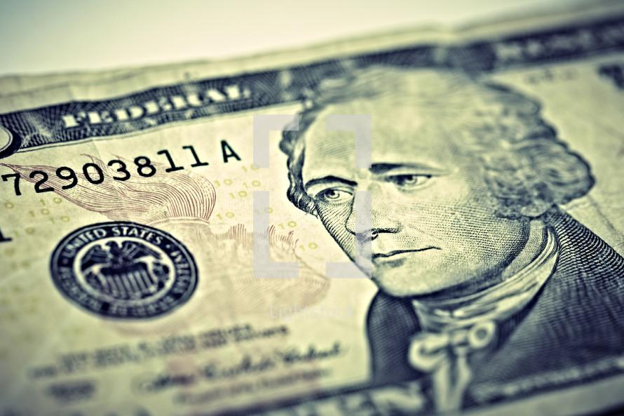 A closeup of a ten dollar bill