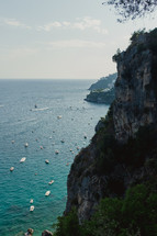 boats on the water by a shoreline in Italy