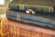 stack of Bibles and wedding rings