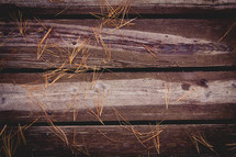 pine straw on wood boards