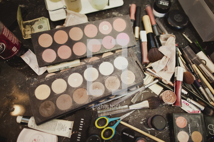 A pile of make-up and brushes