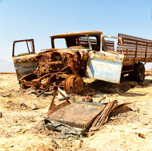 abandoned rusty truck in a desert
