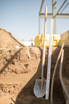 shovel and yardstick at a construction site