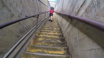 a boy running up stairs