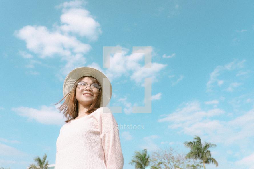 a woman wearing a sunhat