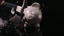 smashing open a piggy bank