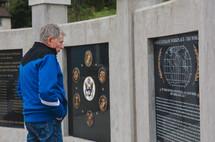 A man at a Veteran's Memorial