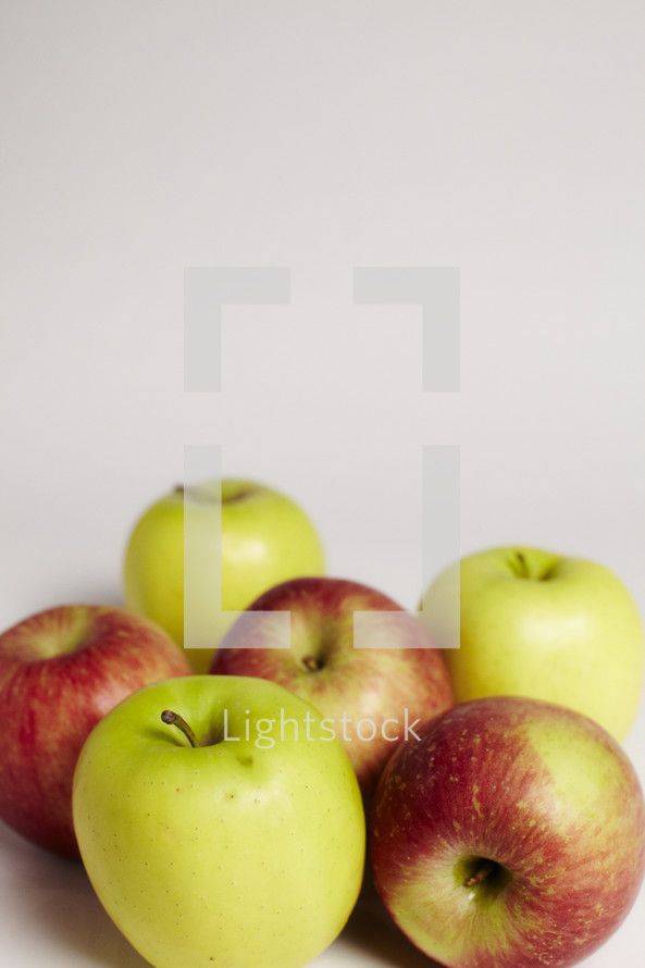 A group of green and red apples isolated on white.