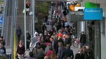 crowds of people walking on sidewalks