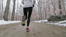 a woman running in winter