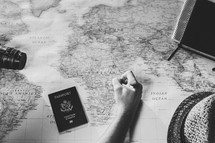 man drawing on a world map, missions preparation