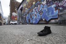 lost shoe in an alley