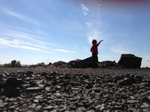 boy throwing rocks