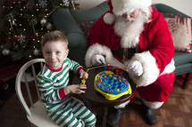 a boy playing with toys with Santa