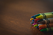 crayons on wood table