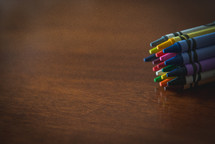 crayons on a wood table
