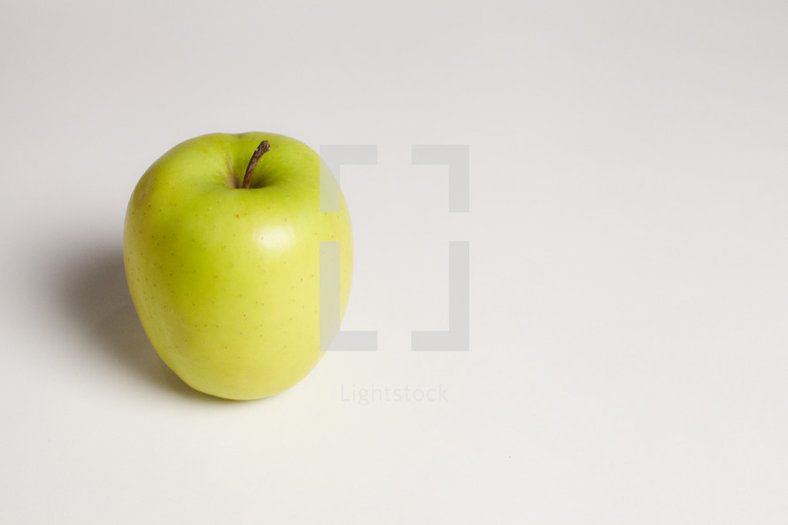 A green apple isolated on white