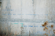 "words ""Fear God and Keep his commandments"" graffiti on a concrete wall"