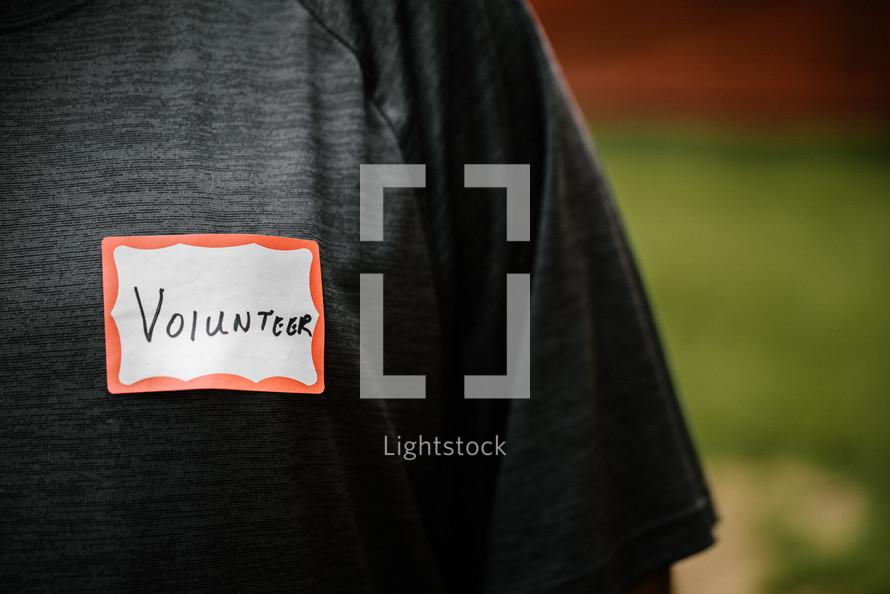 word volunteer on a name tag