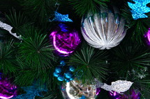 fuchsia, blue and silver ornaments on a Christmas tree
