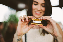 a woman eating a s'more