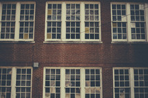 Many paned windows in a brick building.
