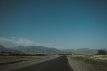 A highway leading toward mountains.