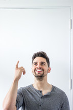 a man pointing up