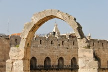 Walls of old city Jerusalem and stone arch