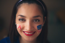 woman with a painted face for July 4th