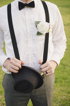 a groom in suspenders